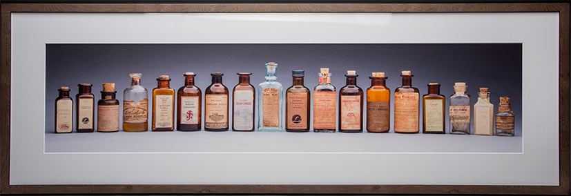 framed print cannabis bottles